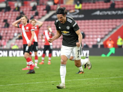 Manchester United's Edinson Cavani celebrates scoring his side's second goal of the game during the Premier League match at St Mary's Stadium, Southampton (Mike Hewitt/PA)