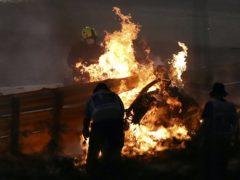 Romain Grosjean's car burst into flame (Brynn Lennon/AP)
