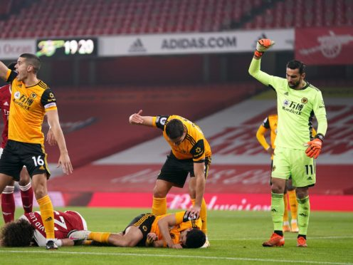 Players reacts after Arsenal's David Luiz (left, floor) clashes heads with Wolverhampton Wanderers' Raul Jimenez (right, floor) during the Premier League match at the Emirates Stadium, London (John Walton/PA)