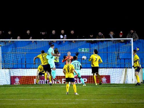 Boreham Wood's Matt Rhead (second left) scores his side's third goal (John Walton/PA).