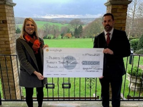 Darren Daughters giving a cheque to a representative of Pilgrims Hospices (Westerleigh Group)