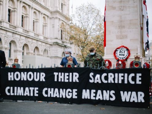 Extinction Rebellion stage protest at the Cenotaph on Remembrance Day (TheLightscaper/PA)