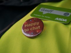 A badge which reads 'Happy to chat' that Asda delivery drivers can wear on their uniforms to help combat loneliness (Asda)