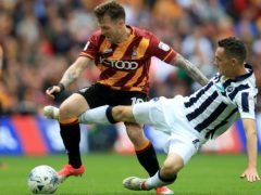 Bradford will check on Billy Clarke, left, ahead of the clash with Cambridge (Mike Egerton/PA)