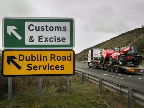 The protocol was designed to maintain a free-flowing border on the island of Ireland (Liam McBurney/PA)