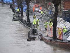 Environment Agency teams work on temporary flood barriers in the Wharfage area of Ironbridge, Shropshire, after floodwaters receded following an emergency evacuation of some properties earlier this week (Matthew Cooper/PA)