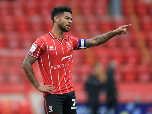 Liam Bridcutt moved to Lincoln permanently in the summer (Mike Egerton/PA)
