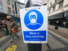 The Government's position on when and where to wear face coverings has changed throughout the coronavirus crisis (Danny Lawson/PA)
