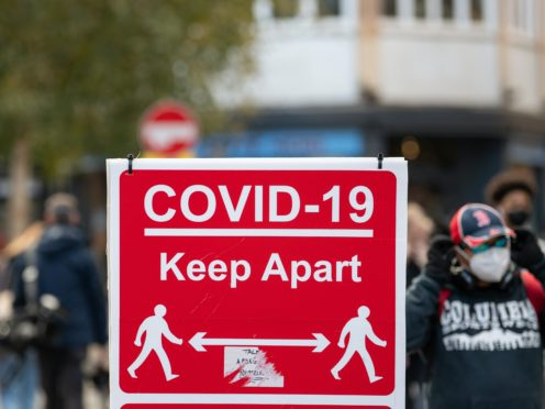 Cocid-19 signage on High Street in Leicester (Joe Giddens/PA)