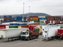Shipping containers and lorry at the Stena Line terminal in Belfast (PA)