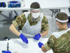 Soldiers carry out mass coronavirus testing in St Johns Market, Liverpool (Peter Byrne/PA)