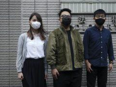 Hong Kong activists Joshua Wong, Ivan Lam and Agnes Chow have been jailed (Vincent Yu/AP)