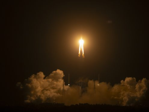 A Long March-5 rocket carrying the Chang'e 5 lunar mission lifts off at the Wenchang Space Launch Centre in Wenchang in southern China's Hainan Province (Mark Schiefelbein/AP)