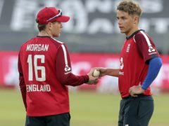 Eoin Morgan (left) has been using off-field messages to guide his captaincy (AP Photo/Halden Krog)