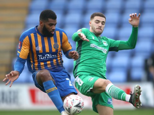 Ethan Ebanks-Landell (left) is unavailable for Shrewsbury (Nick Potts/PA)