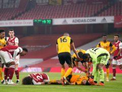 Raul Jimenez suffered a fractured skull after clashing heads with David Luiz (John Walton/PA)