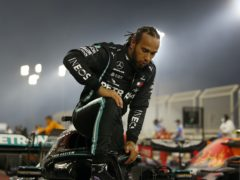 Lewis Hamilton will have to isolate at his hotel in Bahrain for 10 days (Hamad Mohammed/AP)