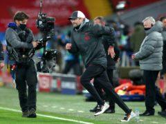Jurgen Klopp celebrates victory at Anfield (Peter Byrne/PA)