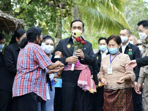 Thailand's prime minister Prayuth Chan-ocha receives flowers from well wishers in Samut Songkhram province, Thailand (Spokesman's Office/AP)