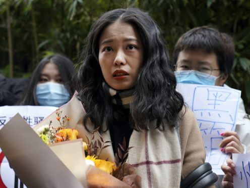 Zhou Xiaoxuan arrives at a courthouse in Beijing for her case to be heard (Andy Wong/AP)
