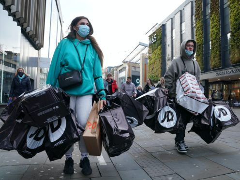 Shoppers laden with bags in Northumberland street, Newcastle (Owen Humphreys/PA)