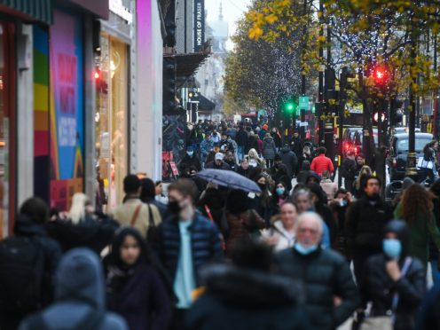 Shoppers on Oxford Street in London, as non-essential shops in England open their doors to customers for the first time after the second national lockdown ends (Kirsty O'Connor/PA)