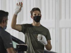 Romain Grosjean has waved goodbye to Haas after withdrawing from the Abu Dhabi Grand Prix (Kamran Jebreili/AP)