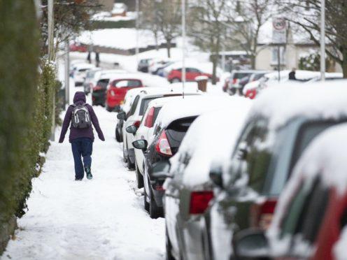 A woman walks through the snow in Penicuik, Midlothian (Jane Barlow/PA)
