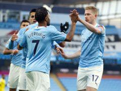 Manchester City's Raheem Sterling (left) celebrates scoring the opening goal against Fulham (Dave Thompson/PA)
