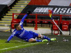 Jamie Vardy breaks a corner flag as he celebrates (Jason Cairnduff/PA)