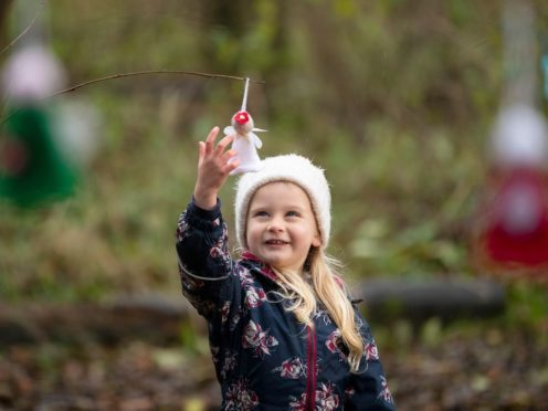 Ellie Pereira,4, finding Christmas fairies in Calton Marshes nature reserve, Lowestoft (Rod Kirkpatrick/National Lottery/PA)