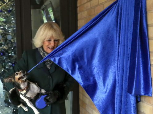 The Duchess of Cornwall unveiled the plaque with assistance from her dog Beth (Steve Parsons/PA)
