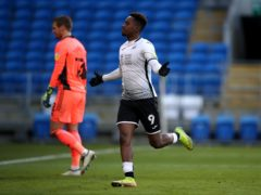 Jamal Lowe celebrates scoring Swansea's second goal in their south Wales derby win at Cardiff (Nick Potts/PA)