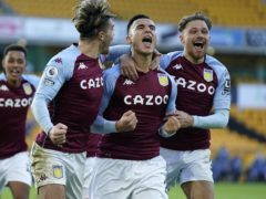Anwar El Ghazi (centre) celebrates his injury-time penalty winner for Aston Villa at Wolves with team-mates Jack Grealish (left) and Matty Cash (right). (Tim Keeton/PA)