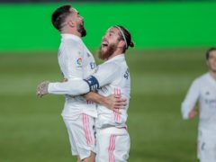 Real Madrid's Dani Carvajal, left, celebrates his goal with Sergio Ramos en route to their side's 2-0 victory of Atletico Madrid (Bernat Armangue/AP)