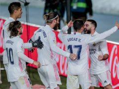 Dani Carvajal celebrates with his team-mates (Bernat Armangue/AP/PA)