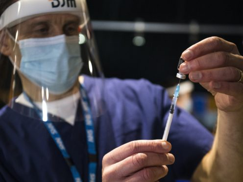 Social restrictions may have to continue until half the population is vaccinated, an expert said (Kirsty O'Connor/PA)