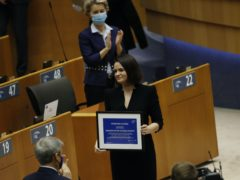 Belarusian opposition politician Sviatlana Tsikhanouskaya picks up the prize (Francisco Seco/AP)