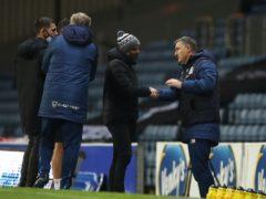 Paul Warne (centre) greets Blackburn manager Tony Mowbray (Martin Rickett/PA)