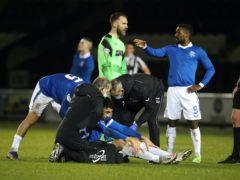 Leon Balogun (sat down) went off against St Mirren (PA)