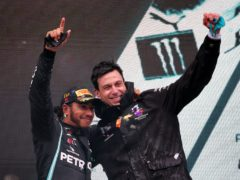 Toto Wolff (right) has no doubt Lewis Hamilton will remain a Mercedes driver (PA)