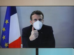 French President Emmanuel Macron went ahead with a planned speech via a video conference call on Thursday (Charles Platiau/Pool/AP)