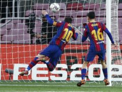 Lionel Messi, centre, scores his 643rd Barcelona goal (Joan Monfort/AP)