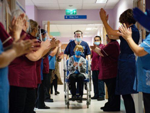 Margaret Keenan, 90, being applauded by staff (Jacob King/PA)
