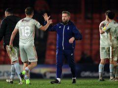 Bradford City caretaker manager Mark Trueman celebrates with Elliot Watt after winning the Sky Bet League Two match at Blundell Park, Grimsby.