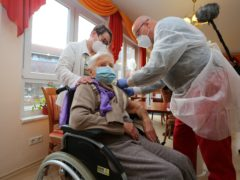 Dr Bernhard Ellendt injects the Covid-19 vaccine into nursing home resident Edith Kwoizalla, aged 101, in Halberstadt, Germany (AP)