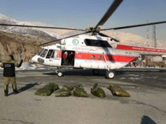 Bags containing bodies of mountaineers who died in the avalanches (Iran's Red Crescent Society via AP)