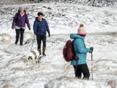 Hikers in snow in Derbyshire (Danny Lawson/PA)
