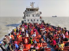 Rohingya refugees on naval ships ahead of being transported to an isolated island in the Bay of Bengal in Chittagong, Bangladesh (Mahmud Hossain Opu/AP)