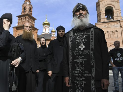 Father Sergiy, right, a monk who has defied the Russian Orthodox Church's leadership (Vladimir Podoksyonov/AP)